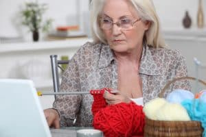 Person knitting from a digital pattern